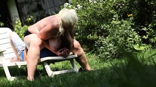 Blonde bbw sitting on stud face outdoors