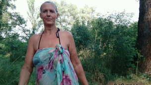 Lukerya peels off her hooter-sling in the woods