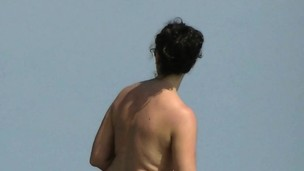 Aluring beach video of nudists enjoying the hot sun