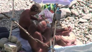 Great old couple on public beach sex